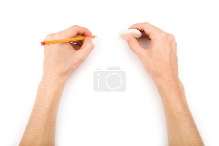 Photo pour Personne gauchère avec crayon et gomme - image libre de droit