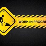 Work in progress over black background vector illu...