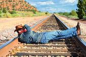 Across train tracks