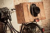 Black Hat and Brown Suitcase on Old Bicycle