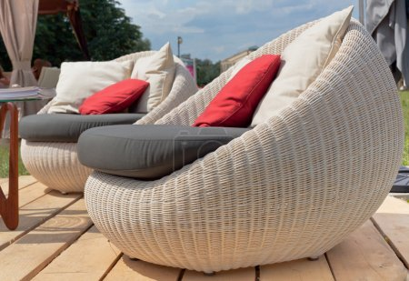 Soft armchairs with color pillows outdoors