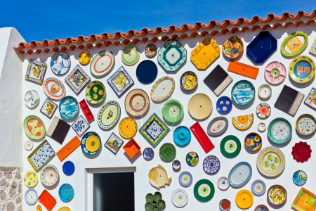 Traditional portuguese pottery plates on a wall