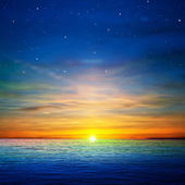 Abstract blue background with stars and golden ocean sunrise