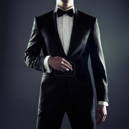 Photo for Photo of stylish man in elegant black suit - Royalty Free Image