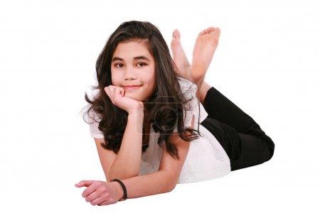 Photo for Beautiful biracial teen girl lying on floor relaxing, feet crossed - Royalty Free Image