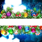 Christmas background with Christmas tree branch decorated with glass balls