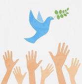 hands releasing white dove of peace