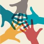 Team symbol. Multicolored hands...