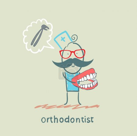 Orthodontist with the jaw in the hands of thinking about the tool for pulling teeth