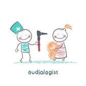 Otolaryngologist yells into a megaphone on patient