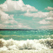 Sea with waves and clouds sky - picture in retro style