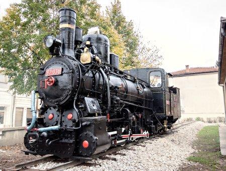 vintage retro historical locomotive train at railroad
