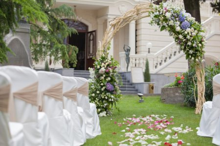 Beautiful wedding gazebo with flower arrangements decorating