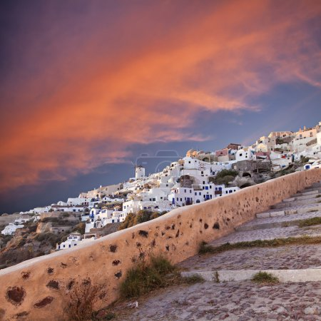 Photo for Image of the famous sunset setting in Oia on Santorini, Greece. - Royalty Free Image