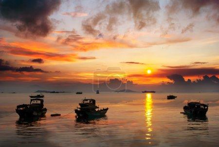 China Hainan,shanya sunset silhouette and boats...