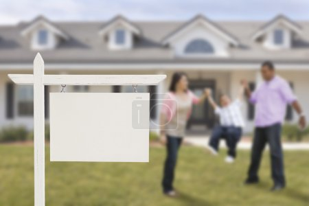 Photo for Blank Real Estate Sign and Playful Hispanic Family in Front of House. - Royalty Free Image