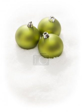 Green Christmas Ornaments on Snow Flakes Isolated on White