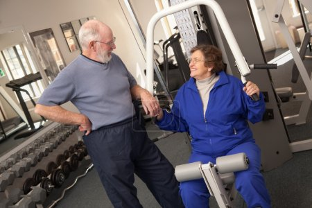 Senior Adult Couple Working Out Together in the Gym