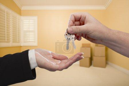 Handing Over the House Keys Inside Empty Room