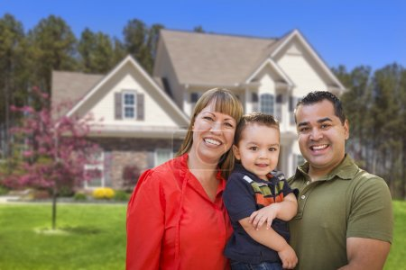Mixed Race Young Family in Front of House
