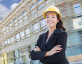 Portrait of Female Contractor Wearing Hard Hat at Construction S