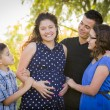 Happy Attractive Hispanic Family With Their Pregna...