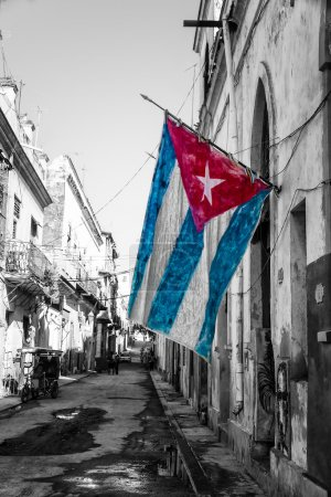 Cuban flag in a shabby street in Havana