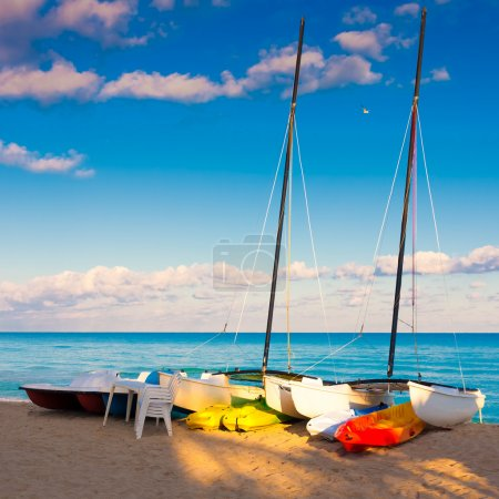 Catamarans, kayaks and pedalos at a beach in Cuba