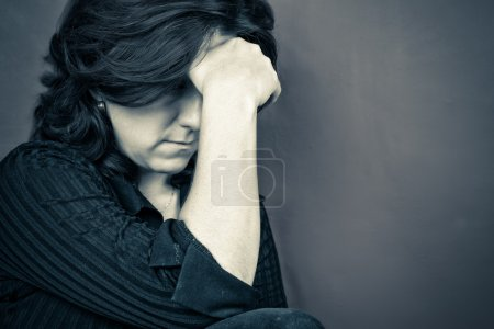 Photo for Blue toned portrait of a depressed woman - Royalty Free Image