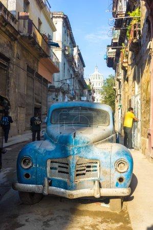 Street scene with an old rusty american car in Havana