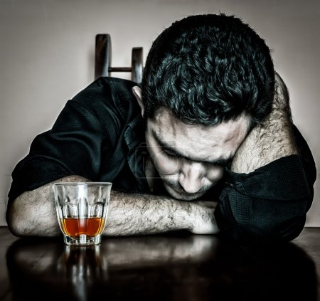 Photo for Alcoholism : Grunge bleached portrait of a lonely and desperate drunk hispanic man - Royalty Free Image