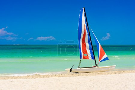 Colorful sailing boat in a cuban beach