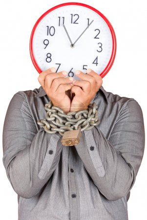 Man holding a clock in place of his face with his hands chained
