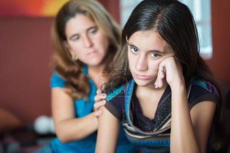 Mother comforts her teen daughter