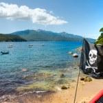 Pirate Flag in Forno beach, Biodola Bay, Elba isla...