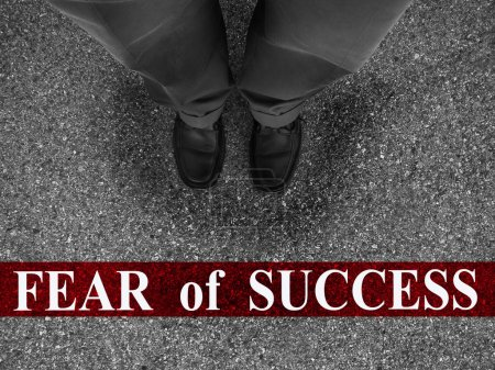 Photo for Businessman standing on asphalt starting line with word fear of success - Royalty Free Image