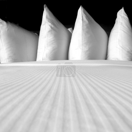 Photo for Group of several white pillows on a comfortable bed - Royalty Free Image