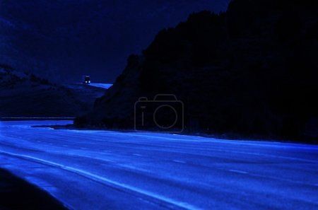 Truck Driving at Night on Curvy Hill