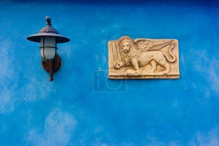 Venetian plate on blue