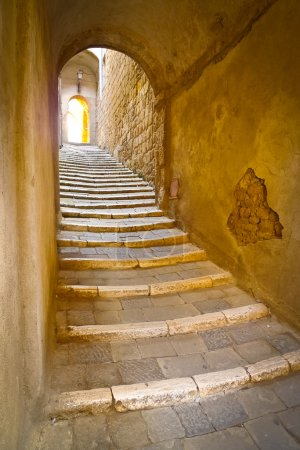 Photo for Stone steps in a remote alley in the picturesque medieval town of Sorano, Grosseto, Tuscany, Italy - Royalty Free Image