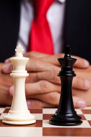 Pair of chess kings in front of businessman