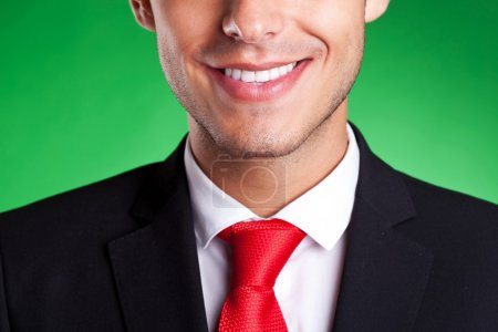 A young red tie business man smiling