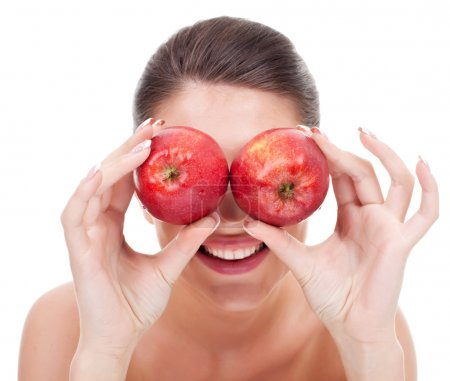 young woman holding apples as binoculars