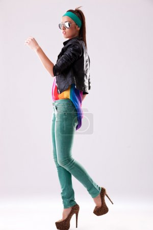 Casual woman stepping forward