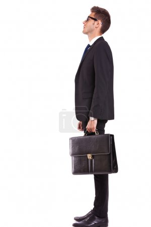 side view of a business man or student looking up