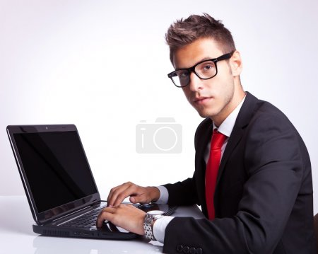 business man seated at computer