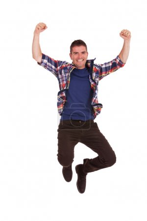 young happy man is jumping in air