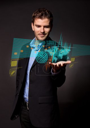 Business man holding virtual digital screen