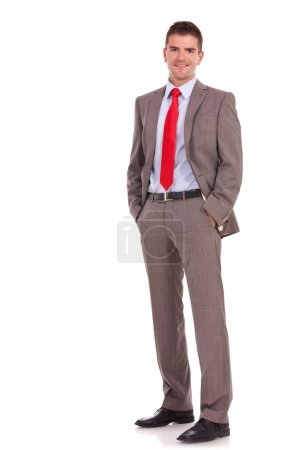 young business man with hands in pockets
