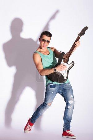 Model rocking on a guitar